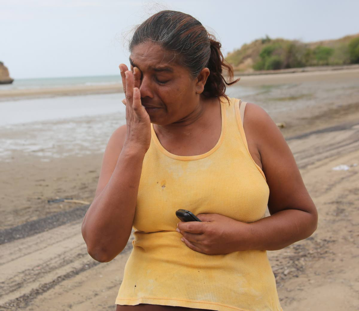 DISTRAUGHT: Hermatie Sankar cries for her husband-to-be Awardnath Hajarie and their son Nicholas who were captured by Spanigh-speaking men in a boat on Thursday.