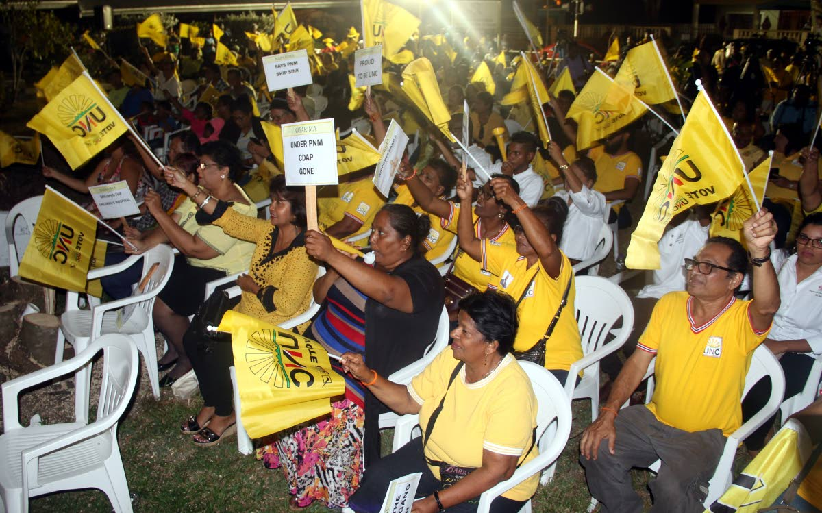 Supporters of the United National Congress in a jubilant mood at the party's Monday Night Forum at the Rochard Douglas Presbyterian School.