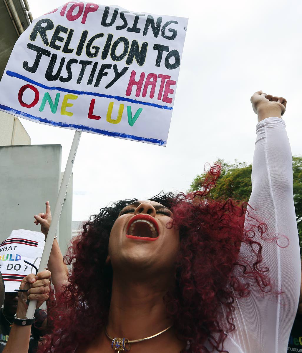 A member of the LGBTQIA community celebrates Justice Devindra Rampersad's ruling that the buggery law is unconstitutional outside the Hall of Justice, Port of Spain last Thursday. PHOTO BY AZLAN MOHAMMED