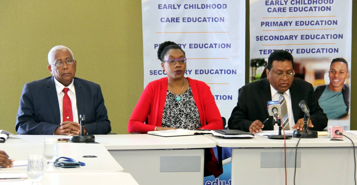 SCHOOL TALK: Education Minister Anthony Garcia, permanent secretary Lenore Baptiste-Simmons and Chief Education Officer Harrilal Seecharan at a news conference yesterday.