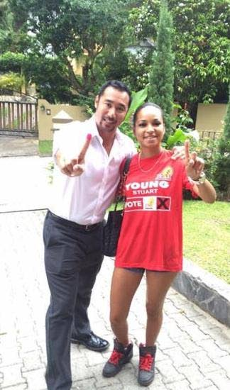 RED AND READY: This photo, posted to social media, shows Stuart Young with her then stepdaughter Krystiana Sankar in the run up to the 2015 General Election. Sankar was kidnapped on Thursday and released yesterday after two ransoms totalling $167,000 were paid.