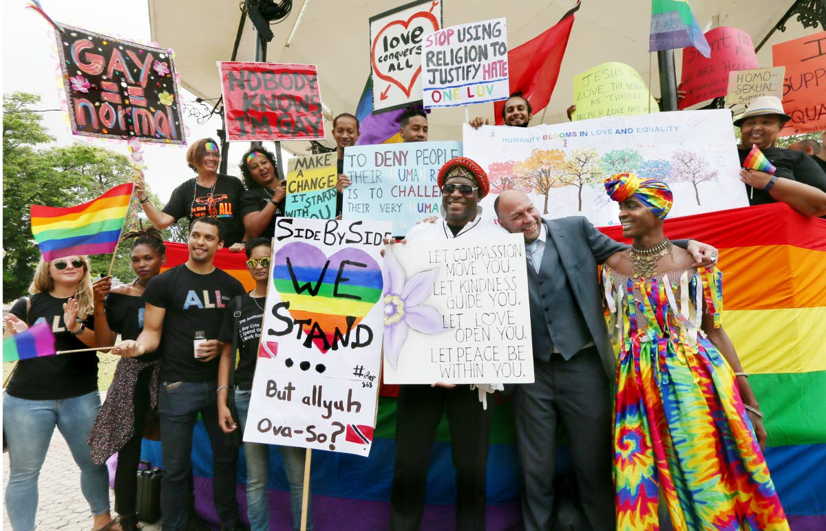 "File photo: Members of the LGBTQI community celebrate with gay rights activist Jason Jones at Woodford Square,  last Thursday, after a High Court judge ruled this country's buggery laws were ""unconstitutional."""