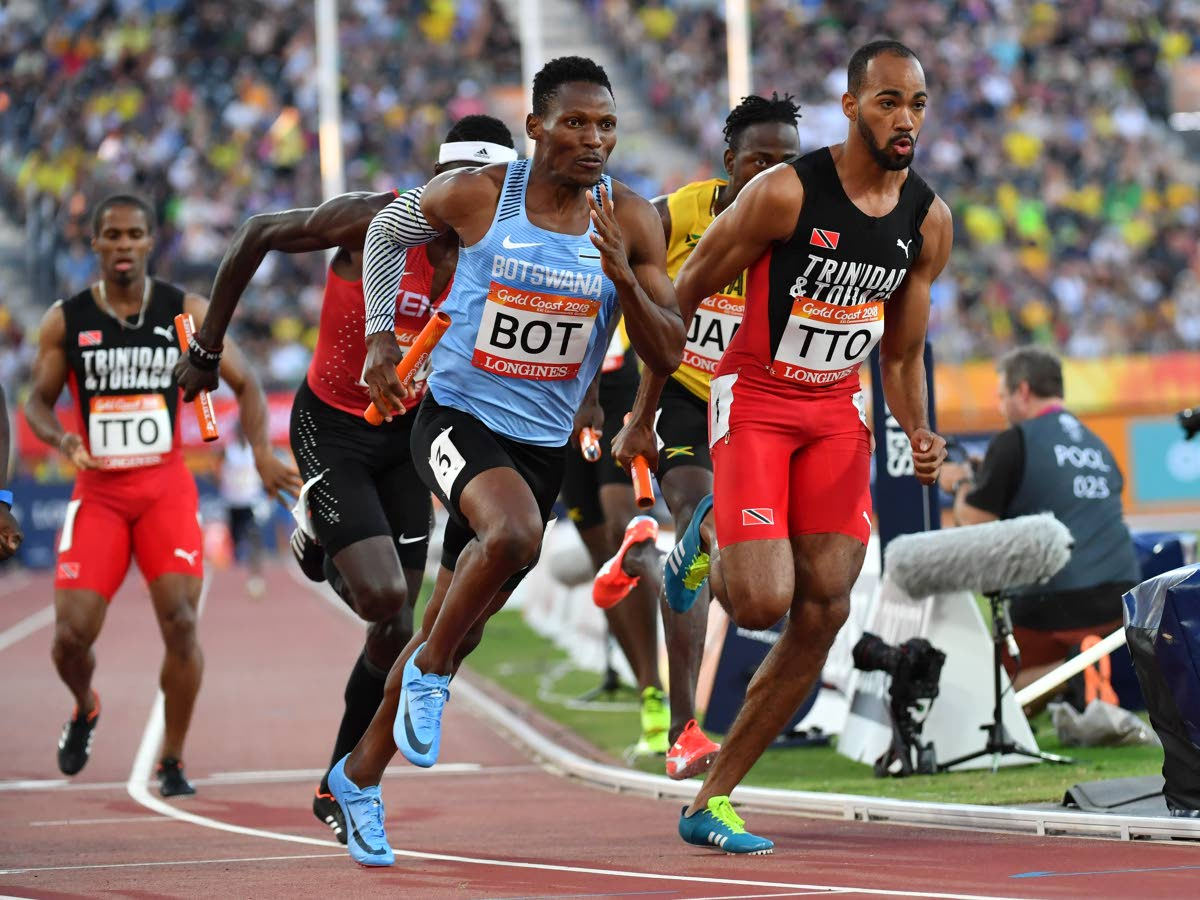 Botswana's Isaac Makwala (L) and TT's Machel Cedenio compete in the athletics men's  4x400m relay final during the 2018 Gold Coast Commonwealth Games at the Carrara  Stadium on the Gold Coast yesterday.(AFP PHOTO)