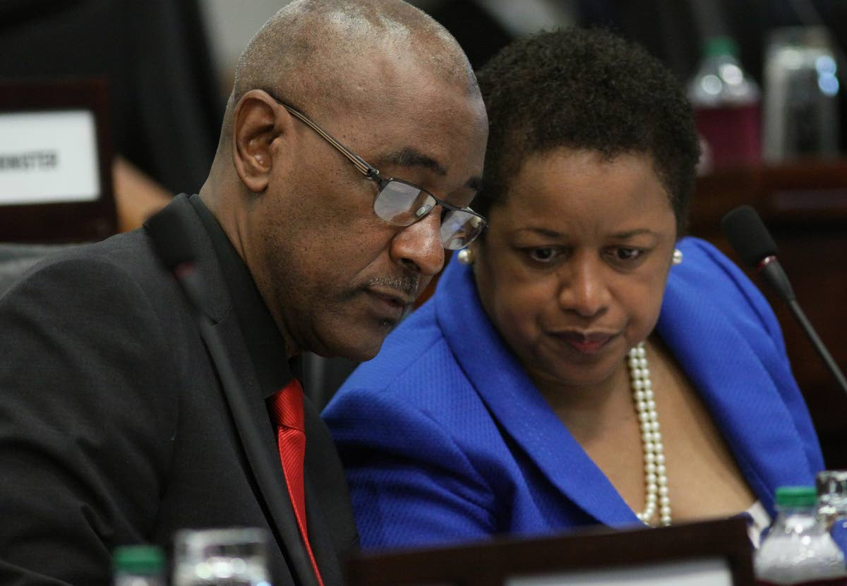 Senator Allyson West, right and Senator Robert Le Hunte at Senate.  PHOTO:ANGELO M. MARCELLE