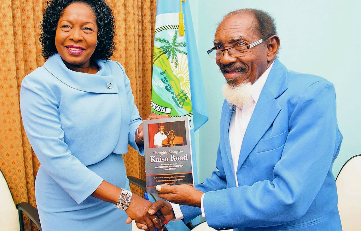 """Professor Hollis Liverpool, The Mighty Chalkdust, right, presents THA Secretary of Community Development, Enterprise Development and Labour, Marslyn Melville-Jack, left, with a copy of his book """"Thoughts Along the Kaiso Road"""", during the UTT Board of Governors visit to Tobago on Monday."""