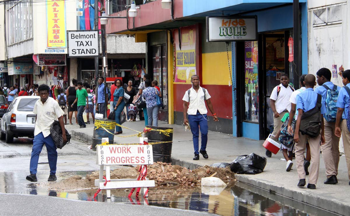 Road repairs to be completed on Charlotte Street in Port of Spain. PHOTO BY ANGELO MARCELLE