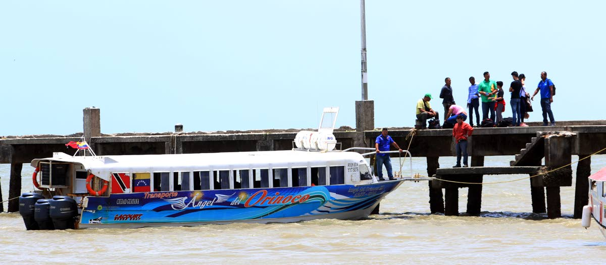 The water taxi, Angel del Orinoco, which transports people between Venezuela and Trinidad is docked at the Cedros port yesterday.   PHOTO BY ANSEL JEBODH