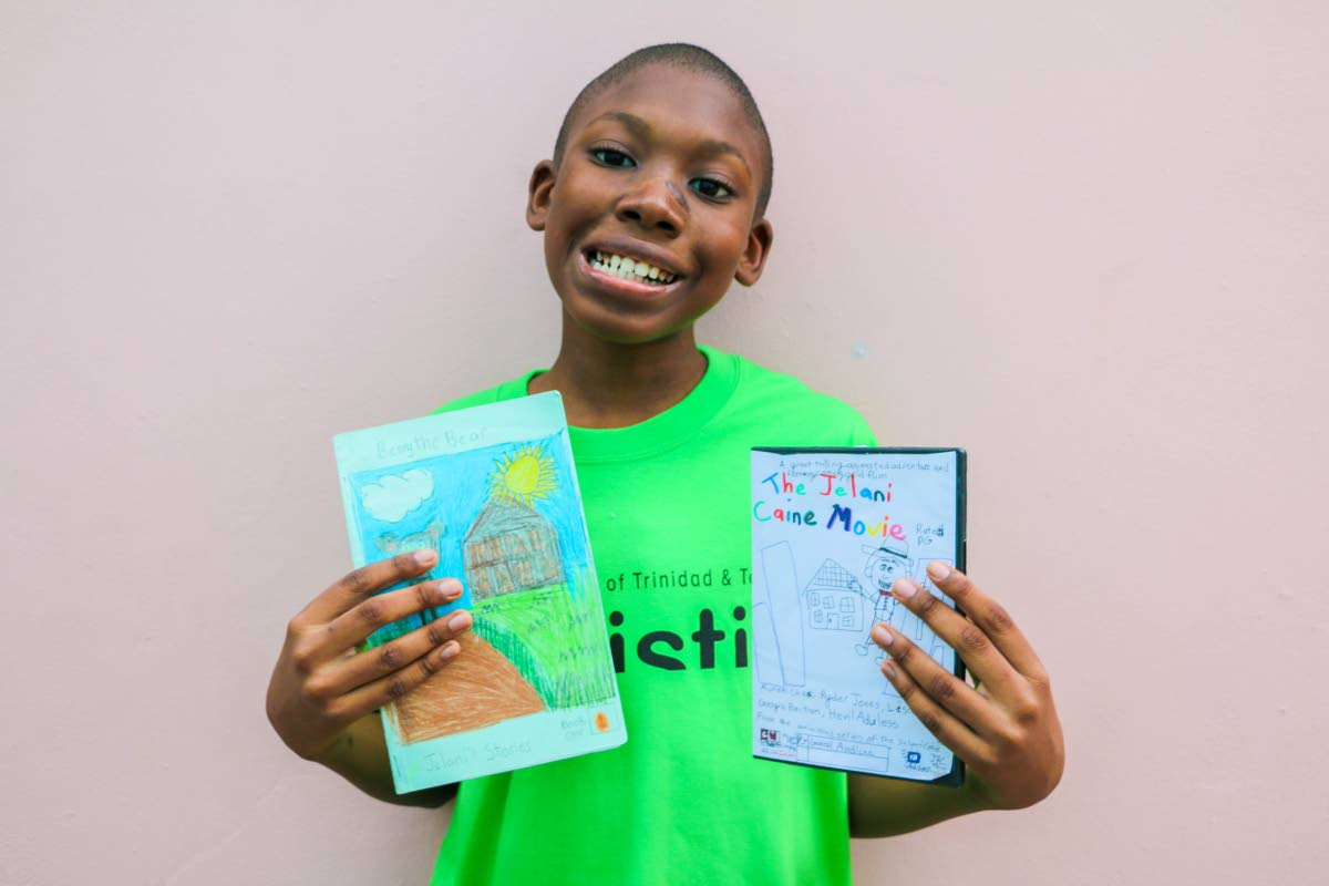 Big dreams: Jelani Caine, who is autistic, displays a book he has written and the case he has created for his yet to be made animation DVD, The Jelani Caine Movie. The 11-year-old dreams his cartoons will one day air on Cartoon Network, Nickelodeon and Boomerang.