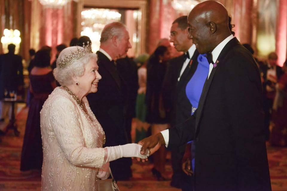 Your Majesty: Prime Minister Dr Keith Rowley greets Queen Elizabeth II at a dinner hosted at Buckingham Palace, on April 19, one of the formal events of the Commonwealth Heads of Government Meeting. Photo courtesy Office of the Prime Minister.