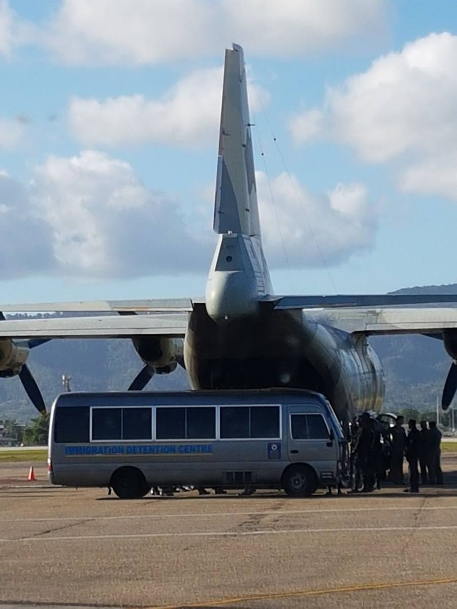 Flight to Venezuela: A Venezuelan aircraft waits alongside an Immigration Detention Centre bus which transported Veneuzelan detainees to Piarco International Airport to be repatriated. Eighty two detainees were returned to Venezuela. Photo courtesy Ministry of National Security.
