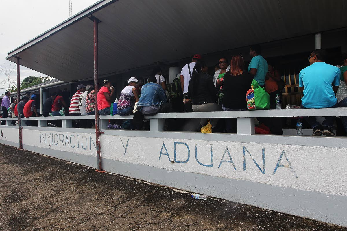 Down in Cedros: Venezuelans wait to be processed by immigration officers at the port in Cedros before returning to the mainland with food supplies on June 1, 2016. Recent reports indicate an estimated 2,000 Venezuelans have sought asylum and activists say the immigrants are exploited for guns, sex and cheap labour. PHOTO BY LINCOLN HOLDER