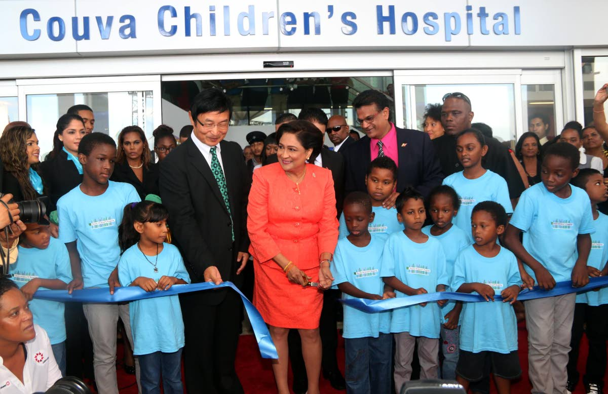 In this August 14, 2015 file photo, prime minister Kamla Persad-Bissessar cuts the ribbon to open the Couva Children's Hospital along with the Chinese ambassador Huang Xingyuan, left, and health minister Dr Faud Khan. Now under the Dr Keith Rowley government, the hospital is to be managed under a public partnership agreement with InterHealth Canada.