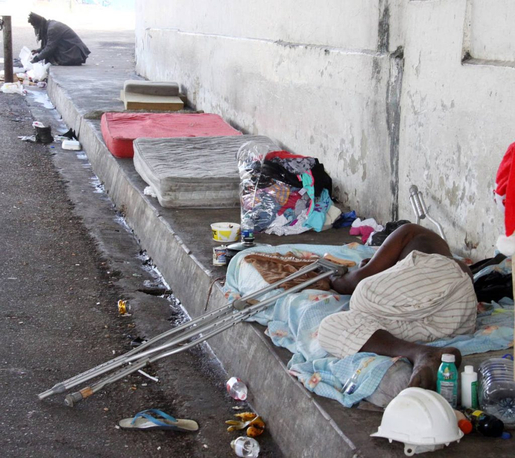 File photo: Homeless people on the ground floor of the Centre for Socially  Displaced People at Riverside Plaza in Port of Spain.