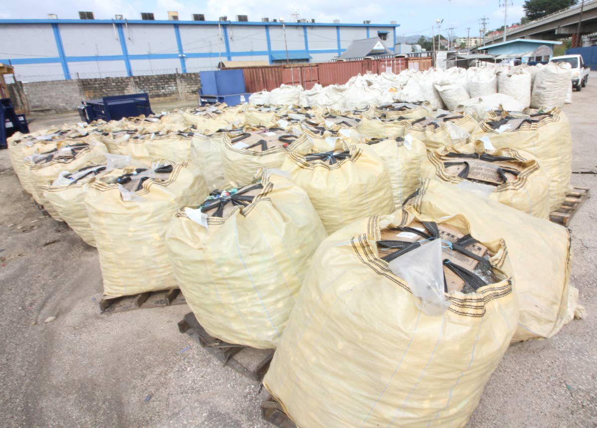 Bags filled with crushed plastic bottles to be repurposed as raw material for the manufacturing industry at the launch of SWMCOL's plastic bottle treatment facility at the Port of Spain market on January 5. File photo