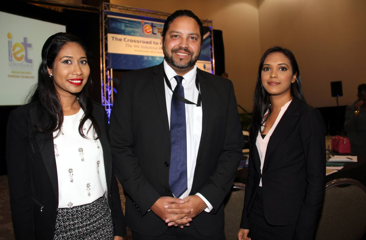 Intellectual Property: (Middle) Regan Asgarali , Controller Intellectual Property Office (TTIPO) with two staff members, (left) Neetu George-Ramsaran and Sharmila Ganpat; both are technical examiners at the TTIPO, at CARIRI's Innovating with Emerging Technolgy Conference at the Hyatt at the Waterfront in Port of Spain. 18-04-18 PHOTO SUREASH CHOLAI