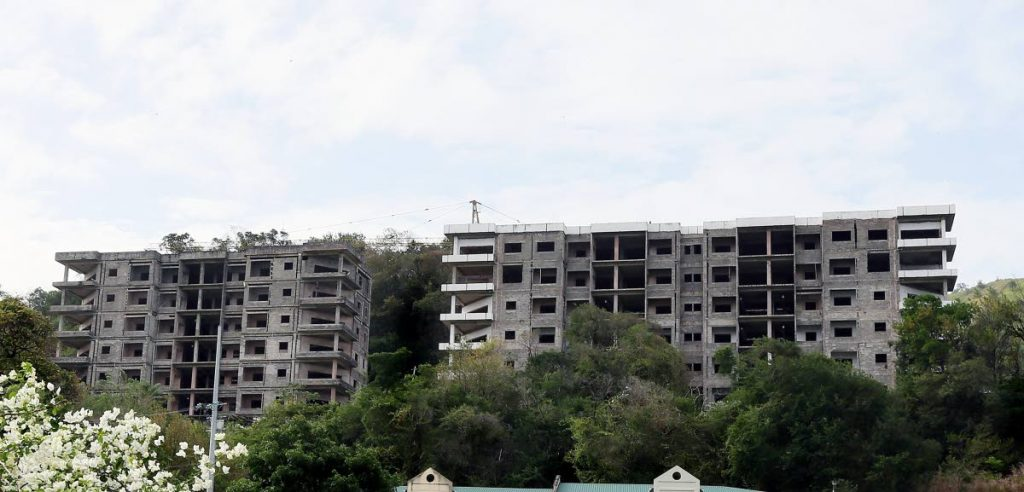 The unfinished Hevron Heights Towers nestled in the hills of Mt Lambert.