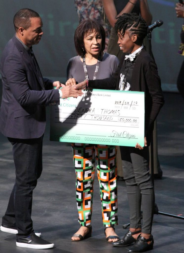 Deneka Thomas, right, is congratulated by  FCB senior manager Jason Julien after winning the 2018 First Citizens National Poetry Grand Slam Final at Napa. In the middle is NGC Bocas Lit Fest founder, Marina Salandy-Brown.