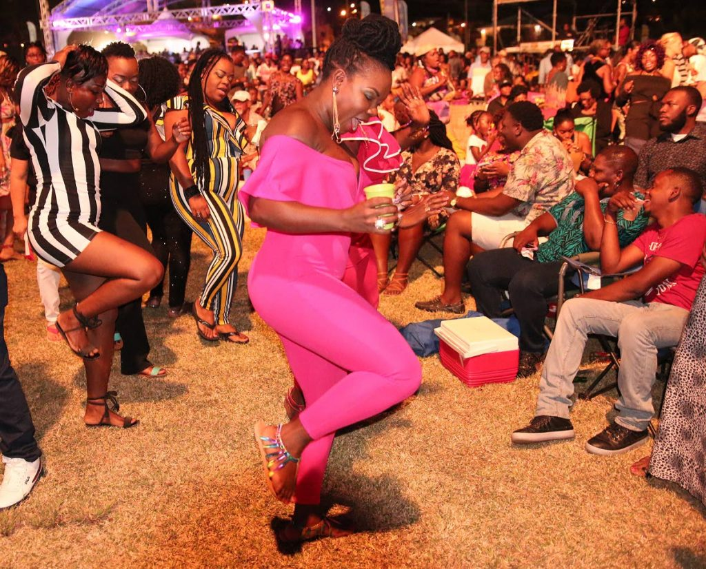 A group of women dance to the music and performance of Jamaica-American reggae artiste Tarrus Riley at the Jazz in the East Caribbean Night of the 2018 Tobago Jazz Experience at the Speyside recreation ground on Saturday night.  PHOTO BY THA Photo