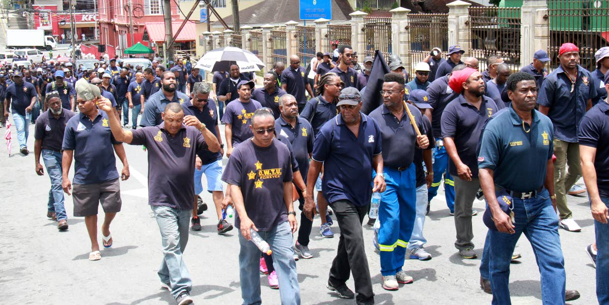 Members of the OWTU trade union take to the streets in San Fernando during May Day obervances yesterday.