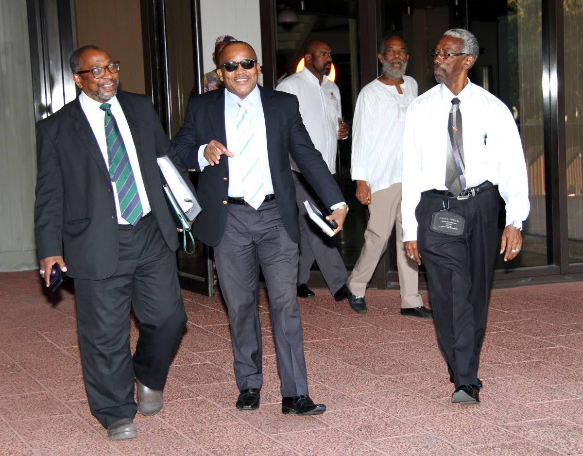 Pan Trinbago Secretary Richard Forteau (far left)  leaves Hall of Justice with his attorneys. PHOTO SUREASH CHOLAI