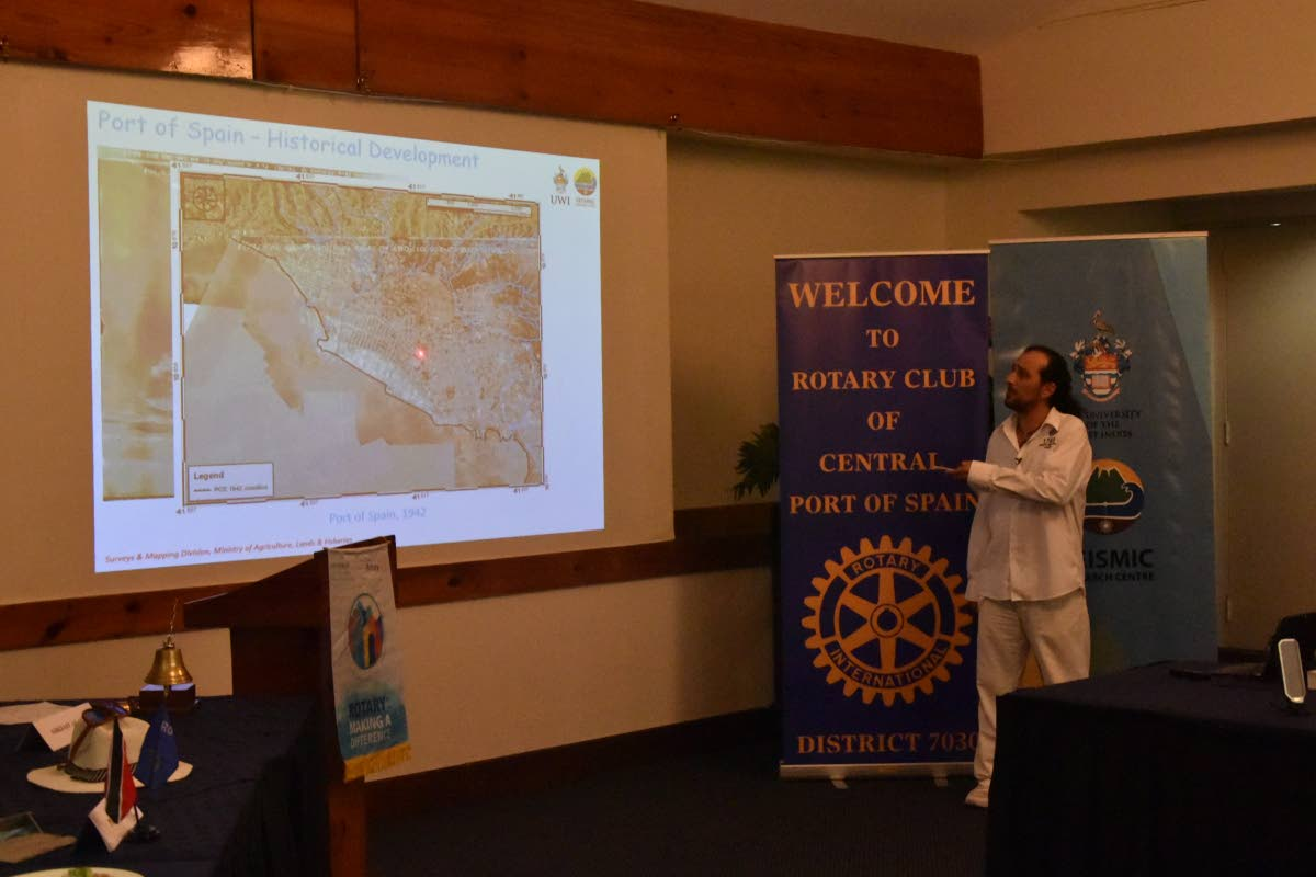 University of the West Indies Seismic Research Centre Engineering Seismologist Ilias Papadopoulos uses a pointer during his presentation yesterday at the Rotary Club of Port of Spain luncheon held at the Normandie Hotel, St Ann's.