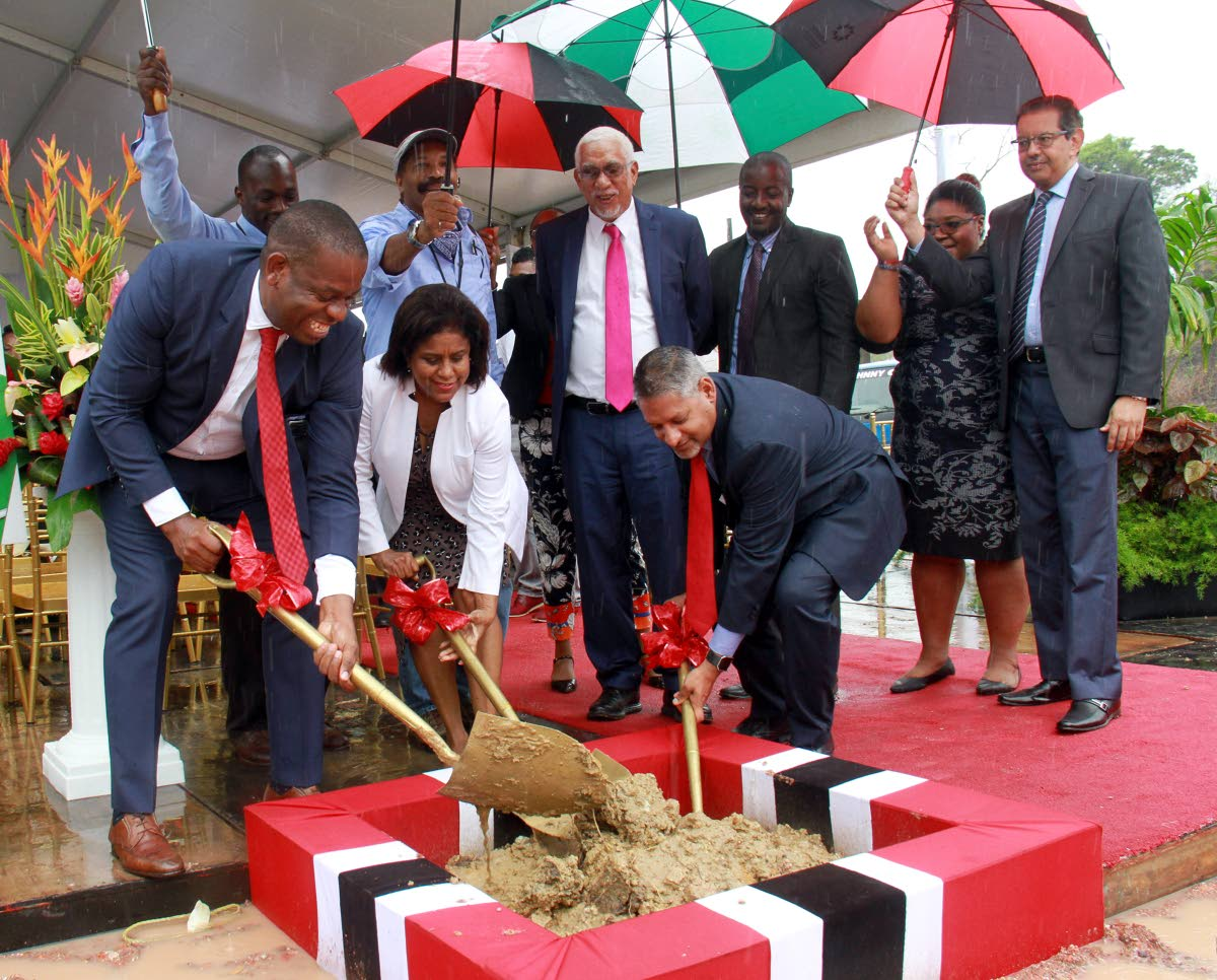 SHOVEL BOSSES: (from left) Moruga Tableland MP Dr Lovell Francis, Trade Minister Paula Gopee-Scoon and Agriculture Minister Clarence Rambharat turn the sod for the start of construction of the Moruga Agro-Processing Park yesterday.