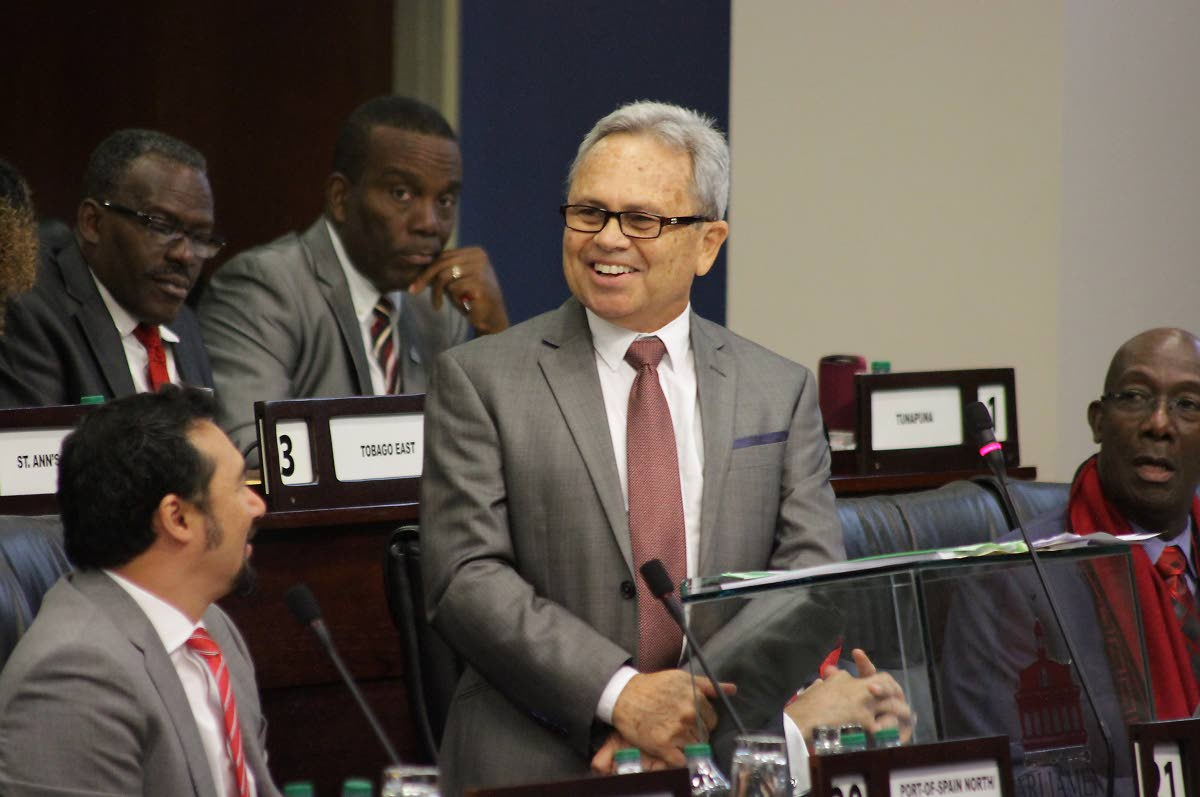 Proud of myself: Finance Minister Colm Imbert makes a confident statement on the economy, as MPs Staurt Young, from left, Edmund Dillon, Lovell Francis and Prime Minister Dr Keith Rowley, right, on the economy during his mid-year review in Parliament last Thursday. PHOTO BY ROGER JACOB