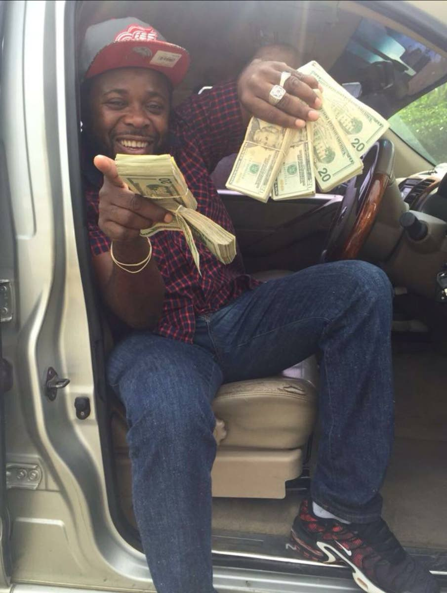 Kendell Richards, seen flashing US currency in a photo, was found shot dead in his car trunk.