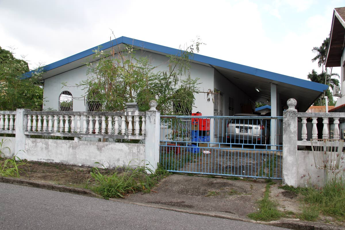 The house at De Graff Street Extension, Arima where businessman Qumehlanj Cao was ambushed and killed yesterday.    PHOTO BY SUREASH CHOLAI