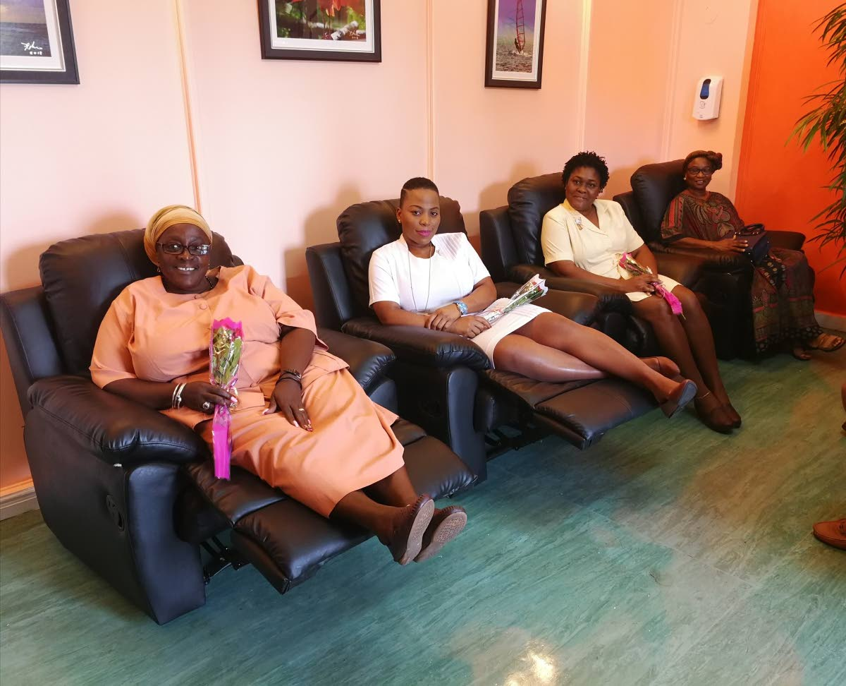 Nursing staff test out reclining chairs in the first-ever Patient Discharge Lounge (PDL), Port of Spain General Hospital during a media tour on May 13, 2018. (Left to right) PDL ward maid Maureen Campbell; PDL nurse Martina Cuffy; Nursing assistant Duane David-Martin; and PoSGH nursing administrator Jacqueline Dasent. PHOTO BY SASHA HARRINANAN.