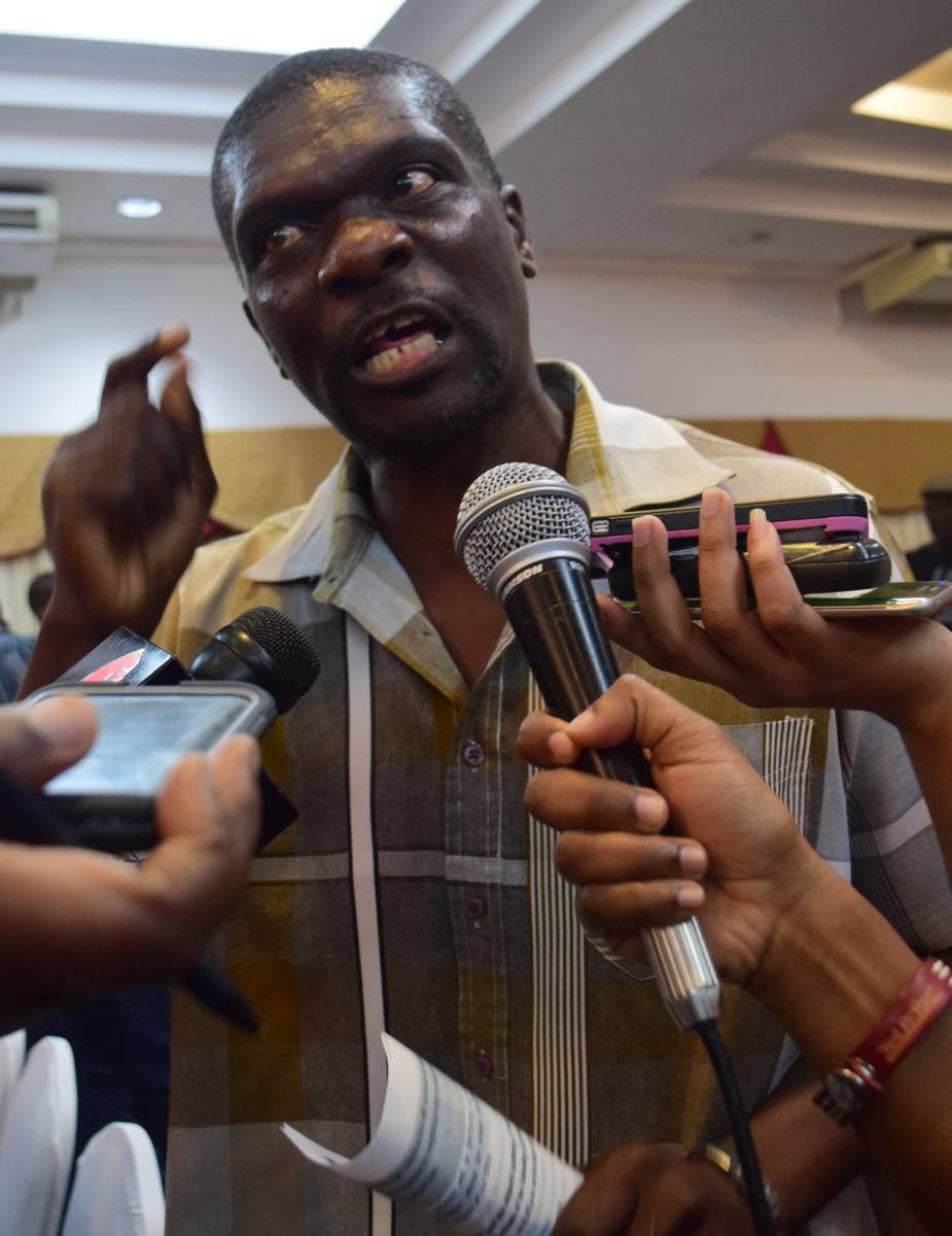 An irate Wolwin Lovell speaks to the media on Monday night following the public public consultation on compulsory land acquisition for the new terminal at the ANR Robinson International airport at Rovanel's Resort. PHOTO BY Vidya Thurab