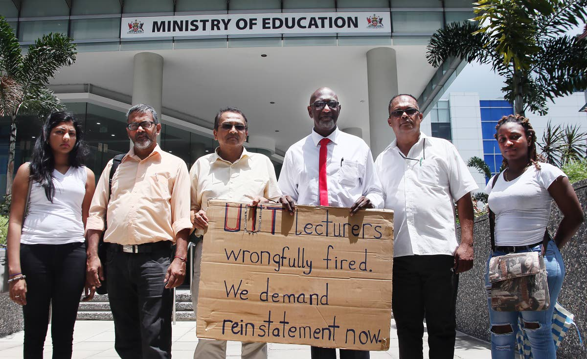 FILE PHOTO: University of TT (UTT) lecturers, seen on May 14 outside the Education Ministry's head office, Edward Street, Port of Spain, are demanding reinstatement. (Left to right) Student Sacha Mohammed, Lecturers terminated leaves the UTT O Meera campus after meeting with officials From Left Rudy Singh, Dr Kumar Mahabir, Solomon Rajnathsingh, Omar  Maraj and UTT Math student Makela Celestine who came out in support of the fired lecturers. PHOTO BY AZLAN MOHAMMED