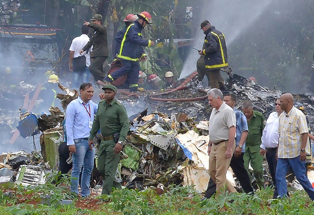 CRASH SITE: Cuba President Miguel Diaz-Canel, 2nd from right, at the site of the accident after a Boeing 737 crashed in a field shortly after taking off from the Jose Marti Airport. AFP PHOTO