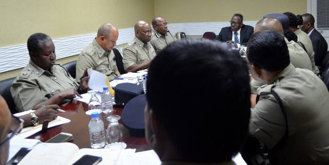 Minister of National Security discusses crime fighting strategies with heads of police divisions during an extensive meeting at the ministry's headquarters on Abercromby Street, Port of Spain today.