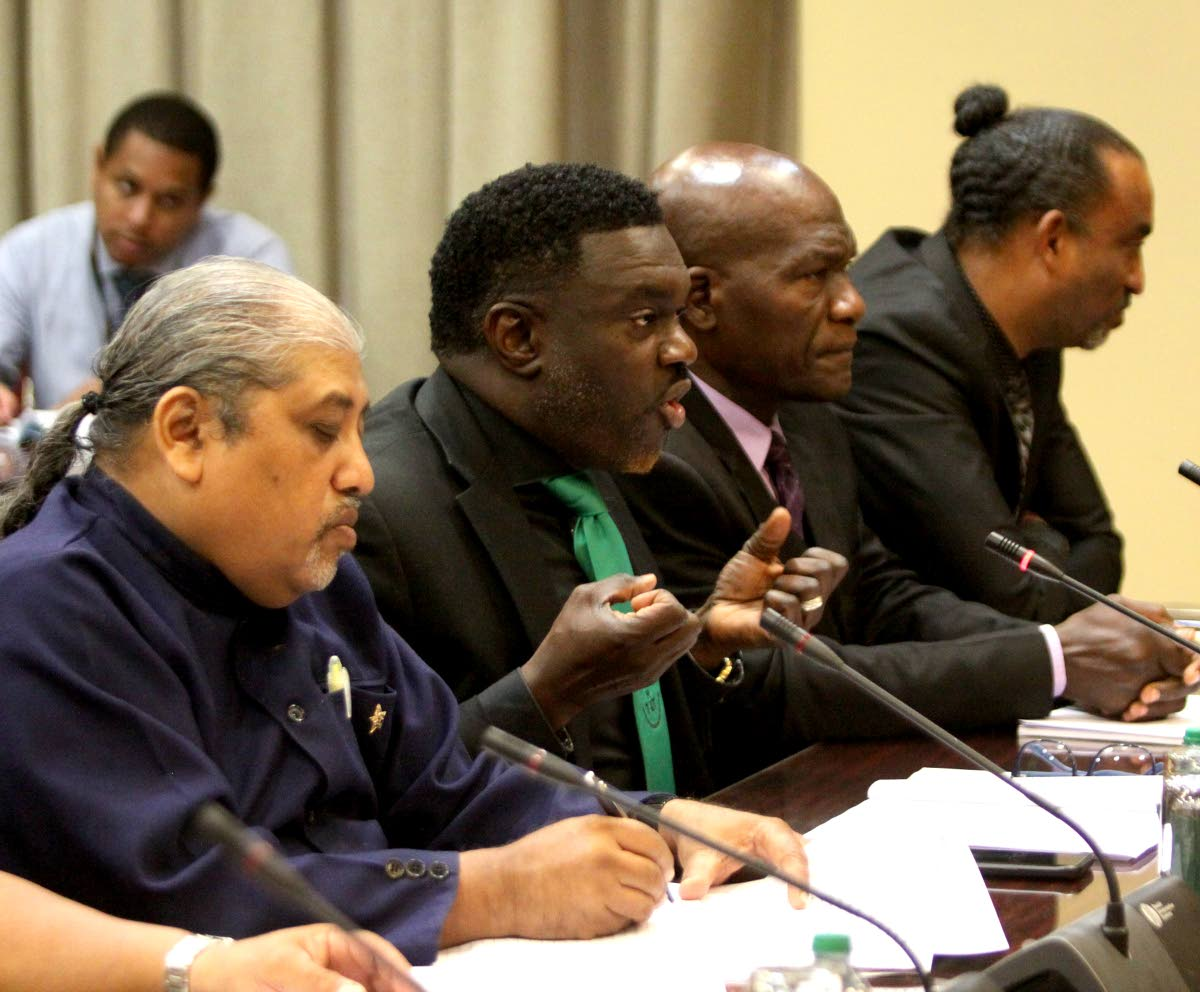 Public Service Association president Watson Duke (second from left) makes a point during a meeting between trade unions and the Consortium of Disability Organisations with the Joint Select Committee on Local Authorities at the Parliament Building yesterday. Next to him (from left) are OWTU treasurer Chandrasain Ramsingh, PSA first vice president Christopher Joefield and second vice president Ian Murray.    PHOTO BY ANGELO M MARCELLE