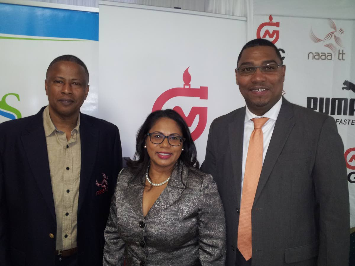 General Secretary of the NAAA, Dexter Voisin, left, poses with Sagicor's Business Development and Marketing manager Lisa Mahabir, centre, and Ronald Adams, vice-president of Operations at NGC, at the launch of June's various track and field championships.