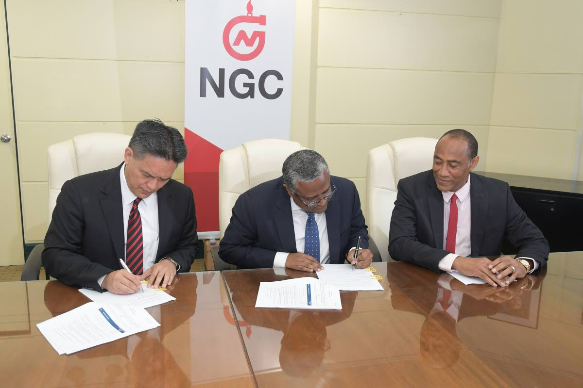 NGC President, Mark Loquan (from left); ENH Chairman and CEO, Dr Omar Mithá and NGC Chairman, Gerry C Brooks sign the Technical Services Agreement at NGC Head Offices. PHOTOS COURTESY NGC