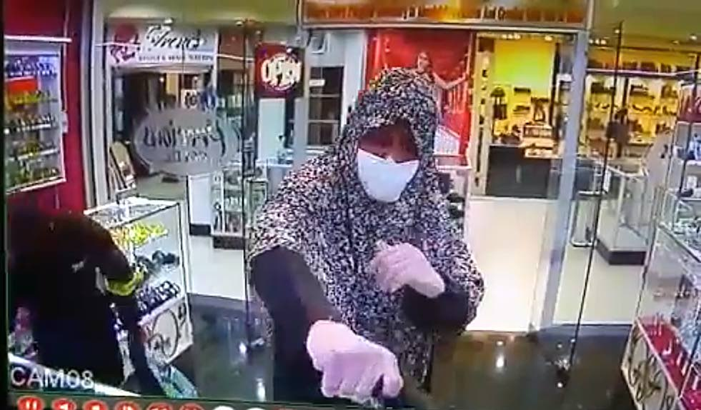 The bandit who was dressed in a niqab, usually worn by  Muslim women.