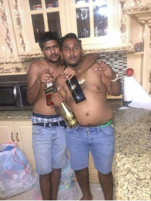 Philip Bassant, left, and his brother-in-law Sheron Sukhdeo enjoying the good times before their murders. Bassant was gunned down yesterday, and Sukhdeo was shot dead on March 26.