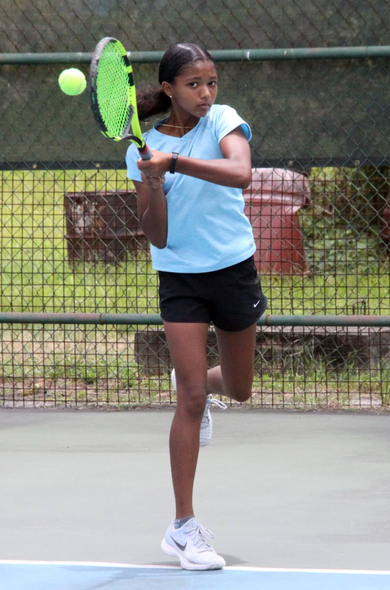 CHAMP: Cameron Wong won the U-14 singles title yesterday at the Lease Operators Junior Tennis held at Trinidad Country Club, Maraval.
