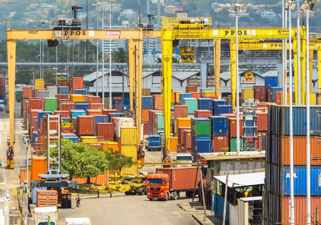 A trailer drives through the Port of Port of Spain. SWWTU president general Michael Annisette said collective bargaining for 2014 to 2017 was settled earlier this year but payments are yet to be made. FILE PHOTO