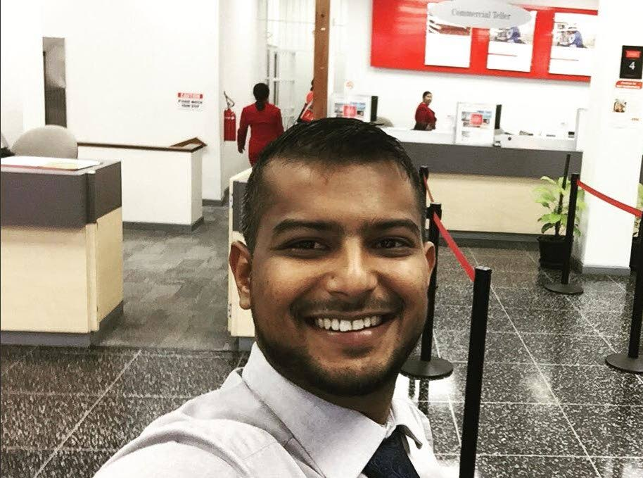 SHOT AND WOUNDED: Scotiabank teller Rostan Mahabir who was shot by a bandit who later stole his laptop.