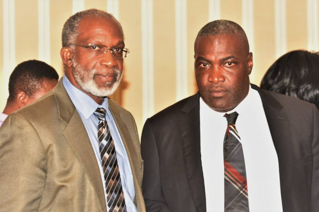 DIVERSIFICATION NEEDED: President of the Tobago Chamber of Industry and Commerce Claude Benoit seen at left in this Tobago Newsday file photo with past president Demi John Cruickshan, is calling for a greater emphasis on diversification of the Tobago economy.