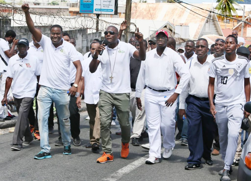 Members of The Lord's Army, led by Christopher Roberts, march through Laventille to reach out to men last Wednesday. FILE PHOTO