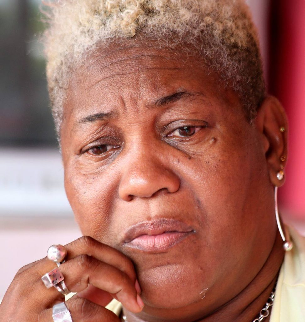 Ann Roberts worries about the fate of her relative, Ashdale Mc Hutchinson, at her Oropune Gardens, Piarco, home yesterday.