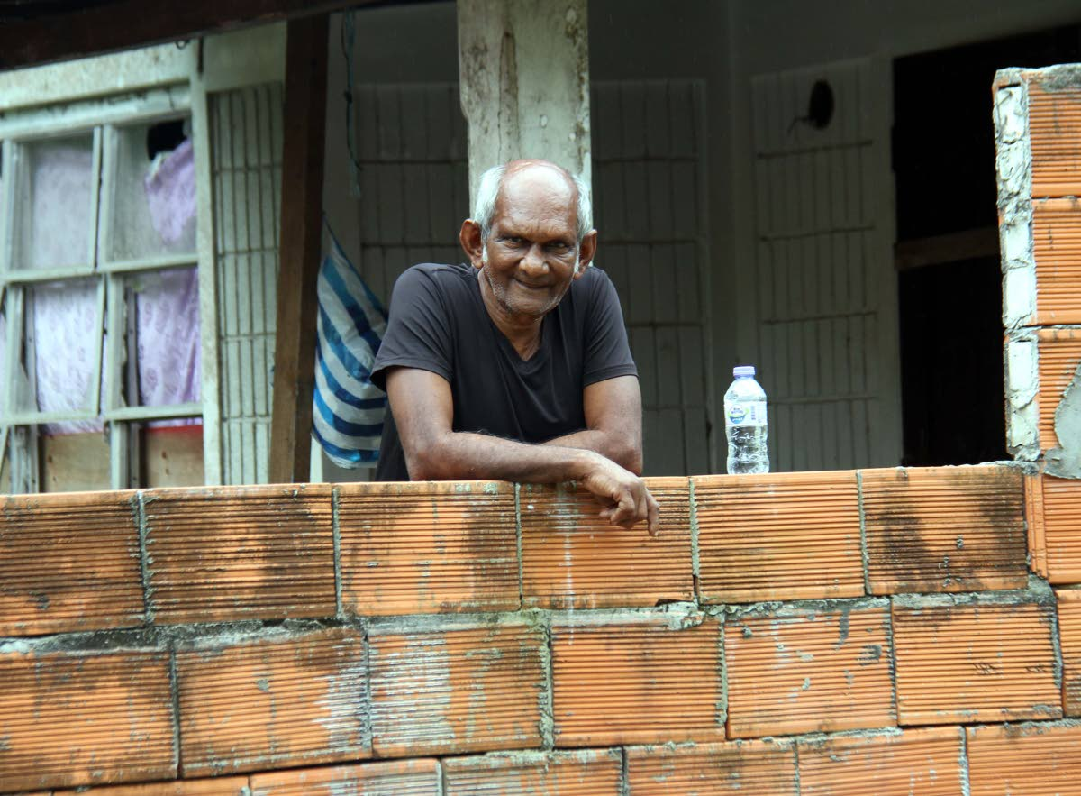 STILL STANDING: Although still traumatised, Carl Ramrattan manages to smile after being robbed by a woman who asked to use his toilet at his Rio Claro home on Saturday.