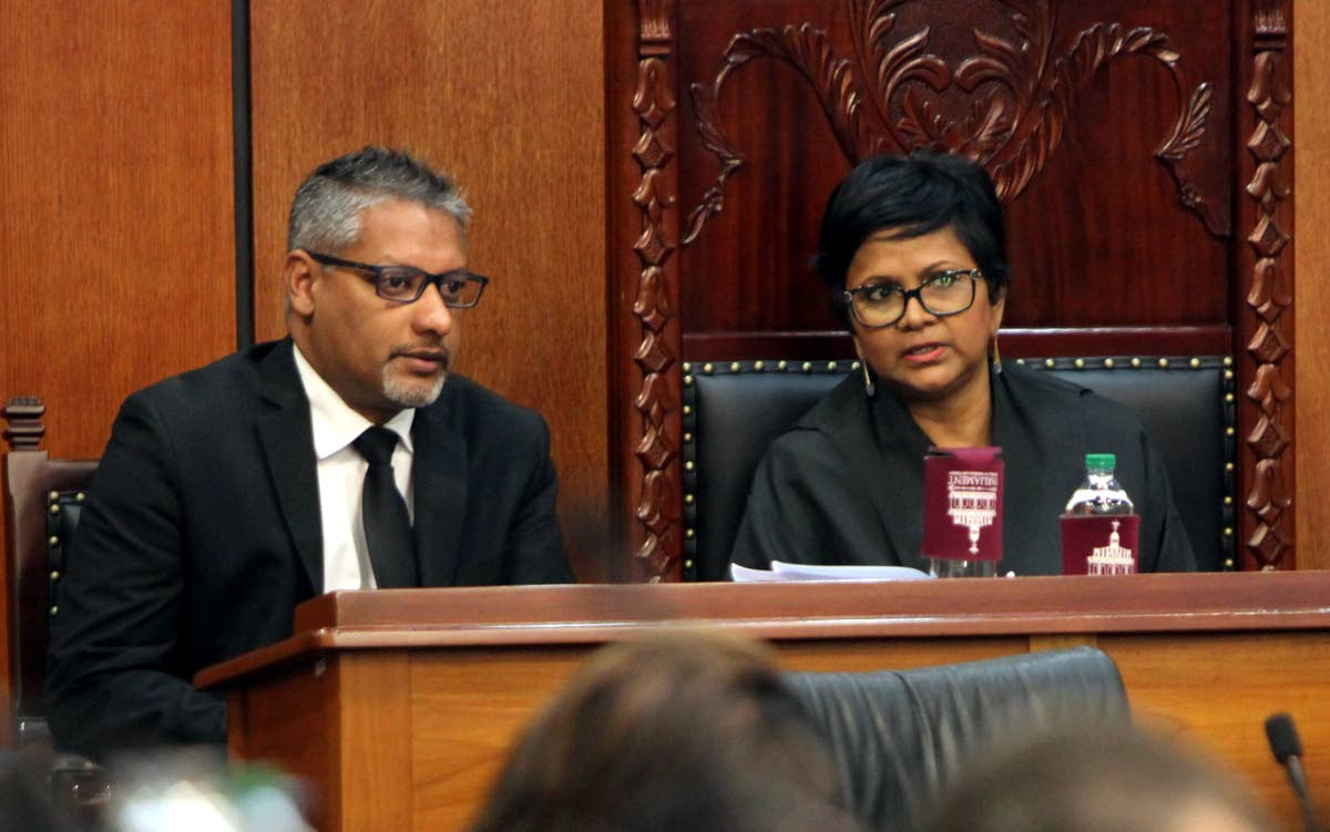 Agriculture, Land and Fisheries Minister Clarence Rambharat speaks with Senate President Christine Kangaloo during a sitting. PHOTO BY SUREASH CHOLAI
