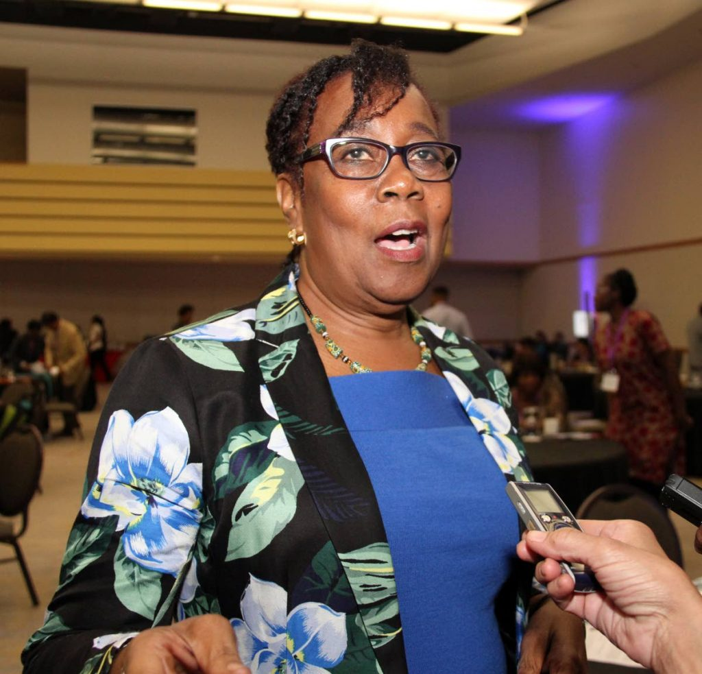 I MISS HIM: Hazel Manning speaks with reporters after the Medical Conference and Community Outreach programme at the Hyatt  yesterday.  She spoke about her husband, former prime minister  Patrick Manning who died two years ago.  PHOTO BY SUREASH CHOLAI