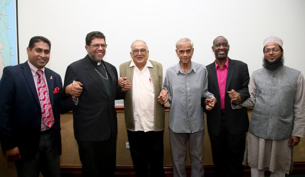 MEN UNITED:From left, Winston Mansingh of the Faith Based Network, Archbishop Jason Gordon, Maha Sabha secretary general Satnarayan Maharaj, ASJA head Yacoob Ali, Desmond Austin of the Evangelical Council and Mufti Mohammed Haque join hands in unity against same-sex marriage which they spoke about during a joint press conference yesterday at Archbishop House in Port of Spain. PHOTO BY AZLAN MOHAMMED
