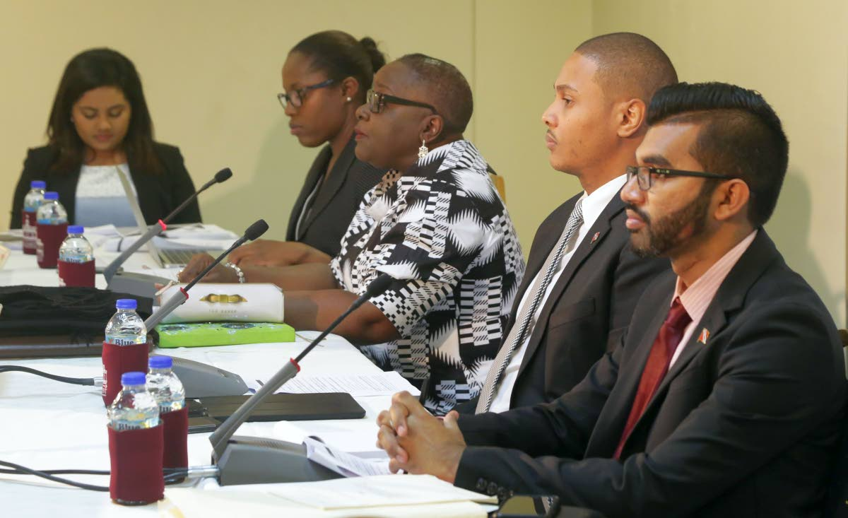 Camille Robinson-Regis, third from left, Chairman of the Joint Select Committee on the Constitution (Amendment) (Tobago Self-Government) Bill, 2018, along with Deputy Chairman, Senator Nigel de Freitas, second from right, and Independent Senator, Saddam Hosein, appear at the public consultation on the bill in Sunday at the Victor E Bruce Financial Complex in Scarborough. Others in photo are, from left, graduate research assistant Melanie Chin and assistant secretary Keiba Jacob. (THA Photo)